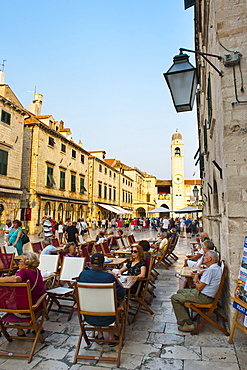 Stradun, the famous street in Dubrovnik, tourists in a cafe by the City Bell Tower, Old Town, UNESCO World Heritage Site, Dubrovnik, Dalmatia, Croatia, Europe