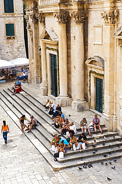 Tourists on the steps of Dubrovnik Cathedral (Cathedral of the Assumption of the Virgin Mary), Dubrovnik, Croatia, Europe