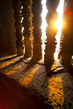 Sunset through stone pillars at Angkor Wat, Angkor Temple Complex, UNESCO World Heritage Site, Siem Reap Province, Cambodia, Indochina, Southeast Asia, Asia
