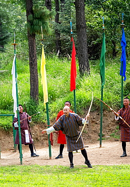 Men compete in an archery competition, Bhutan's national sport, Bhutan, Asia