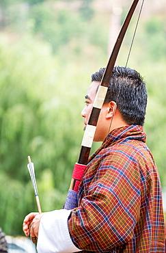 Portrait of man at archery competition, Bhutan's national sport, Bhutan, Asia