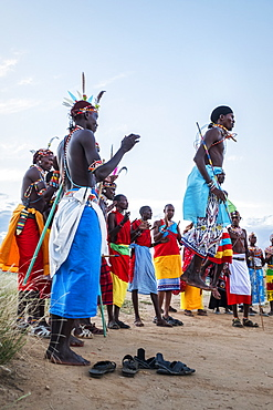 Portrait of Samburu tribe members jumping at traditional wedding dance at dusk, Kenya, East Africa, Africa