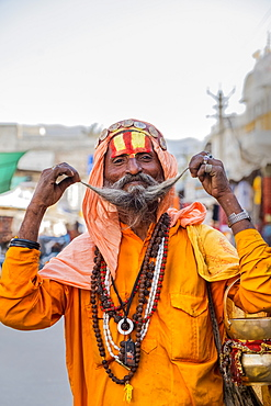 Portrait of Sadhu in orange robes in Pushkar, Rajasthan, India, Asia