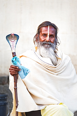 Portrait of Sadhu with cobra cane in Varanasi, India