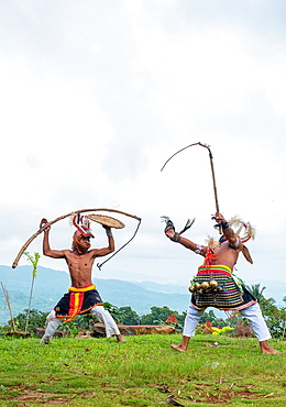 Caci men perform a traditional whip dance with bamboo shields and leather whips, western Flores, Indonesia, Southeast Asia, Asia