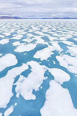 Shorefast ice starting to melt in Maxwell Bay, Devon Island, Nunavut, Canada