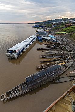 Various boats along the banks of the Amazon River, Loreto, Peru, South America