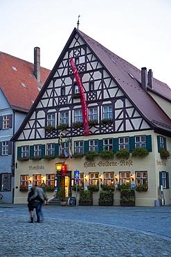 Hotel Goldene Rose in the old town at dusk, Dinkelsbuehl, Franconia, Bavaria, Germany