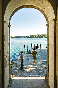 View through a archway to Lake Orta, Isola San Giulio, Piedmont, Italy