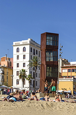 Girls sunbathing on Barceloneta beach, Sculpture by Rebecca Horn, Barcelona, Spain
