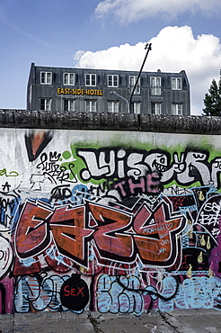 Berlin Wall with graffiti and East Side Hotel, Friedrichshain, Berlin, Germany
