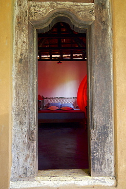 View through the door in a rustic room of the Eco-Resort The Samadhi Center, resort in the mountains near Kandy, Sri Lanka
