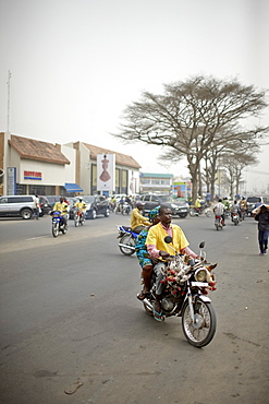Zemidjans motorcycle taxi on the way to market, Ganxi, Cotonou, Benin