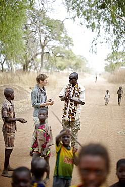 Journalist and guide visiting Tian Sa Wassaga village, out of Penjari National Park, Benin