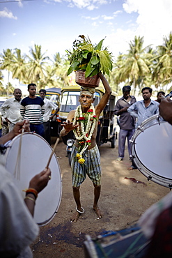 Pilgrim carrying holy water on his head while dancing, Mysore, Karnataka, India
