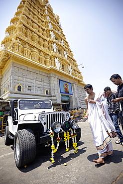 Priest blessing a jeep, Chamundeshwari Temple, Mysore, Karnataka, India