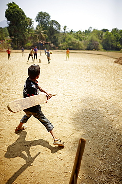 Boys playing cricket, Kakkinje, Karnataka, India
