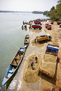 Manual sand quarrying at Sita river, Udipi, Karnataka, India