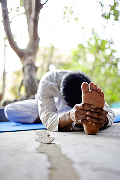 Man practicing yoga, Gokarna, Karnataka, India