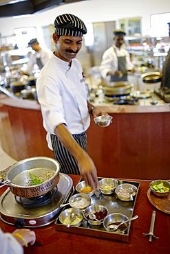 Chef showing ingredients in a hotel restaurant, Gokarna, Karnataka, India