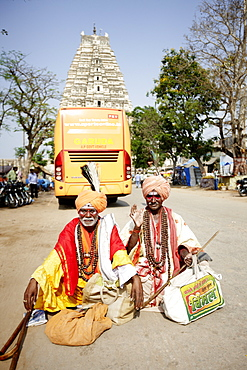 Street magicians, Virupaksha Temple in background, Hampi, Karnataka, India