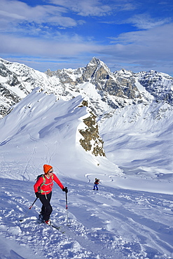 Female back-country skier ascending to Ellesspitze, Pflersch Valley, Stubai Alps, South Tyrol, Italy