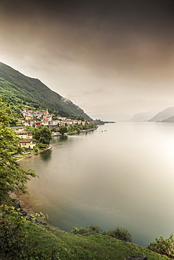 Steep coast with view to Dorio village during rain, Lake Como, Lombardy, Italy, Europe