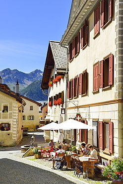 Guests in a pavement cafe, Guarda, Lower Engadin, Canton of Graubuenden, Switzerland