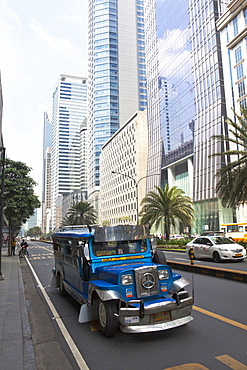 Jeepney typical phillipine public transport, Ayala Avenue in Makati City, the financial and business district in the center oft