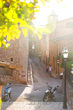couple walking down an alley, romantic mountain village, Lemon tree, Biniaraix, Serra de Tramuntana, Majorca, Balearic Islands, Spain, Europe