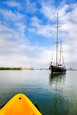 Kayak tour and sailing boat in the lagoon, Parque Natural da Ria Formosa, Faro, Algarve, Portugal