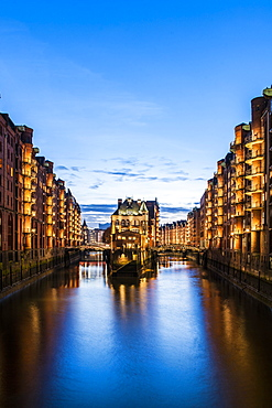 view to the Watercastle in the old Speicherstadt in the twilight, Hafencity of Hamburg, north Germany, Germany