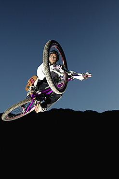 Mountain biker jumping, Oberammergau, Bavaria, Germany