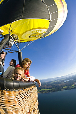 People enjoying a ride on a on hot air balloon, Upper Bavaria, Bavaria, Germany