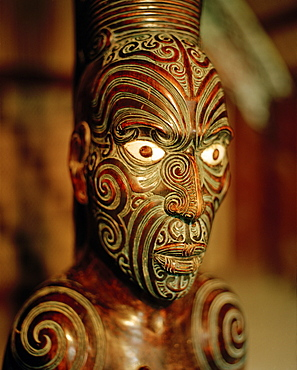 Carved figure on main pole at marae meeting house, Maori and Colonial Museum, Okains Bay, Banks Peninsula, South Island, New Zealand