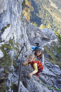 Mother and daughter climbing on Kofel, Ammergau Alps, Bavaria Germany