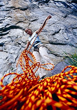 View at woman with climbing rope, Ticino, Switzerland, Europe