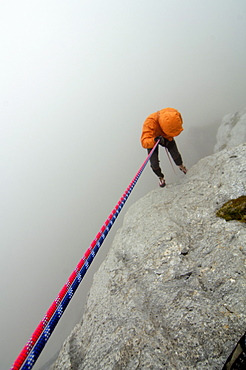 Climber roping in the fog, Tyrol, Austria, Europe