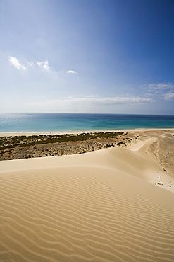 Dune on the waterfront in the sunlight, Playa de Satovento de Jandia, Parque Natural de Jandia, Jandia peninsula, Fuerteventura, Canary Islands, Spain, Europe