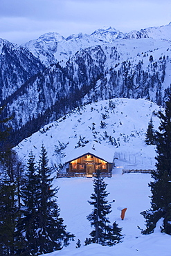 View to illuminated alpine hut (Hochwurzenalm), Schladming, Ski Amade, Styria, Austria