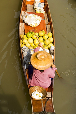Woman in a wooden canoe at Floating Market, Damnoen Saduak, near Bangkok, Ratchaburi, Thailand
