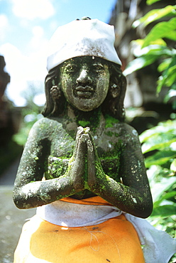 tempel statue with cloth, kitamani, bali, indonesia