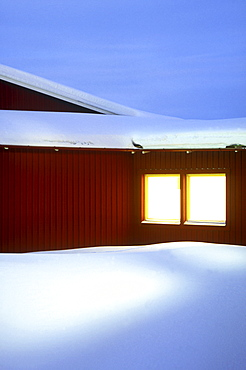 Snow covered hotel in the evening, Arjeplog Municipality, Lappland, Sweden