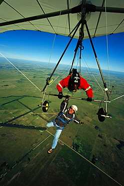 Man hanging below of a hang glider