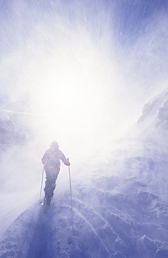 Back country skier at Posets in blizzard, Pyrenees, Spain