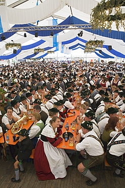 People wearing traditional clothes sitting in a beer tent, Konigsdorf, Upper Bavaria, Germany
