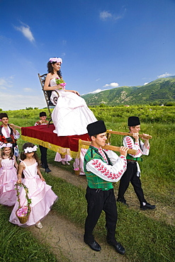 Rose Queen, young woman is carried in a sedan, Rose Festival, Karlovo, Bulgaria, Europe