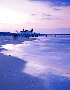View over beach with pier in sunset, Ahlbeck, Usedom, Mecklenburg-Western Pomerania, Germany