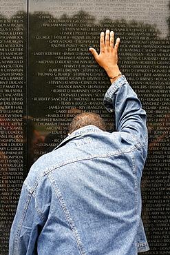 A man at the Vietnam Veterans Memorial, Washington DC, United States, USA