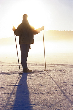 Cross country skiing on snow, descending fog, Vastergotland, Sweden
